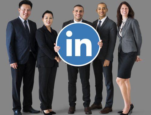 Business people holding a Linkedin logo